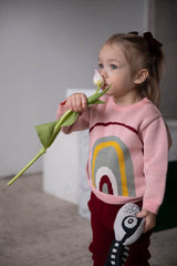 Baby girl is celebrating 8th March in knitted organic cotton sweater