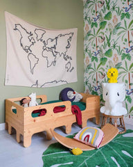 Green pistachio boys room interior with knitted cushion