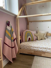 Pink room interior for little girls featuring knitted decor as accents