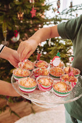 Muffins with sprinkles under the Christmas tree