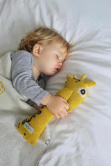 Boy sleeps with giraffe toy from Nordic lemon toy collection