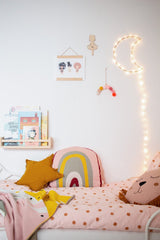 Nursery with white walls and pink knitted organic decor