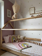 House bed is decorated with knitted interior items