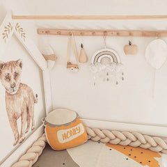 Soft beige nursery with mustard accent with knitted cushion