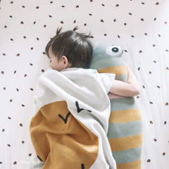 Baby boy hugs with sprat fish shaped cushion