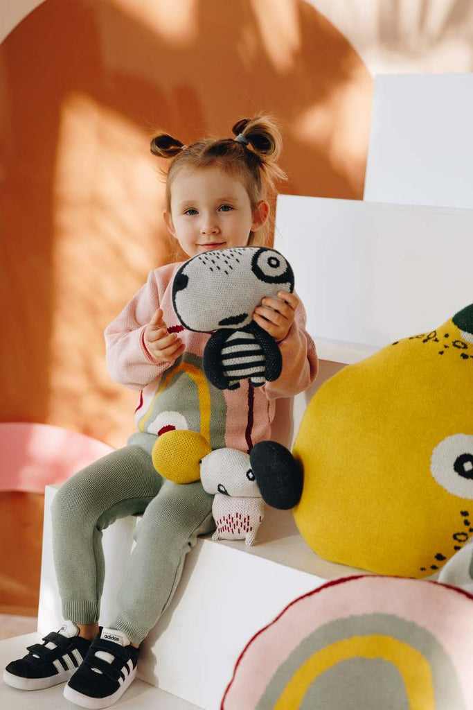 Nordic lemon girl plays with yeti toy from mini interior collection.