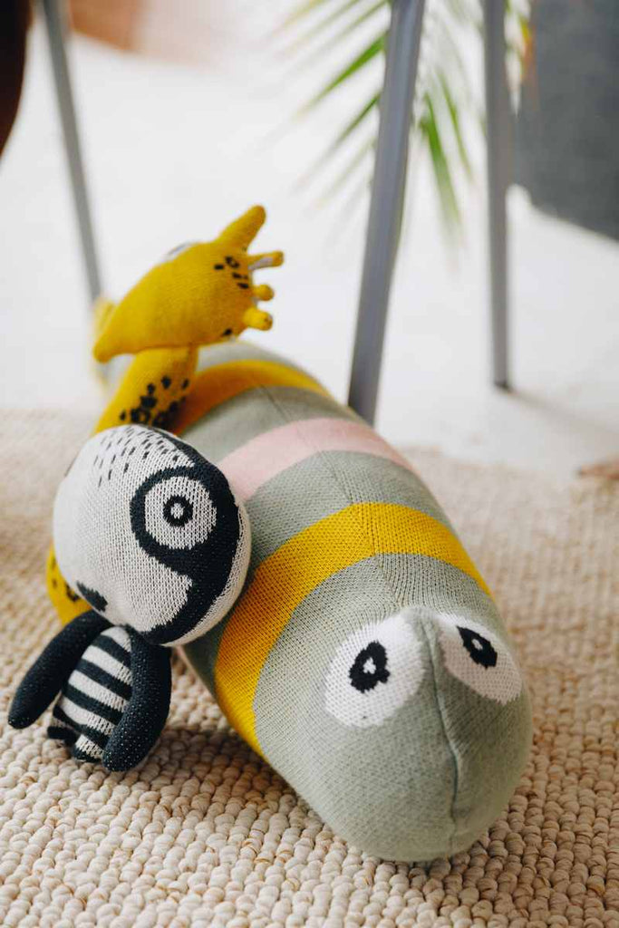 Nordic lemon organic cotton knitted sprat cushion and yeti mini friend. Organic sustainable materials- green urban living.