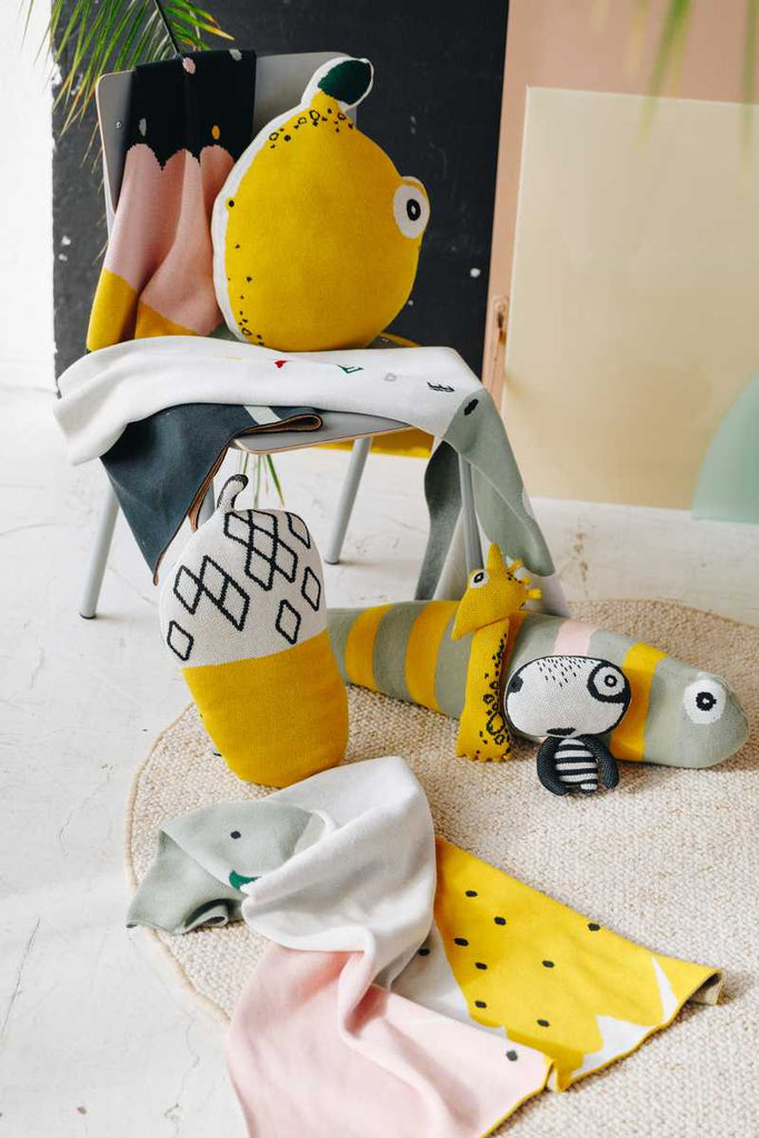 Nordic Lemon mini interior collection features GOTS organic cotton shaped cushions, mini friends and knitted blankets.