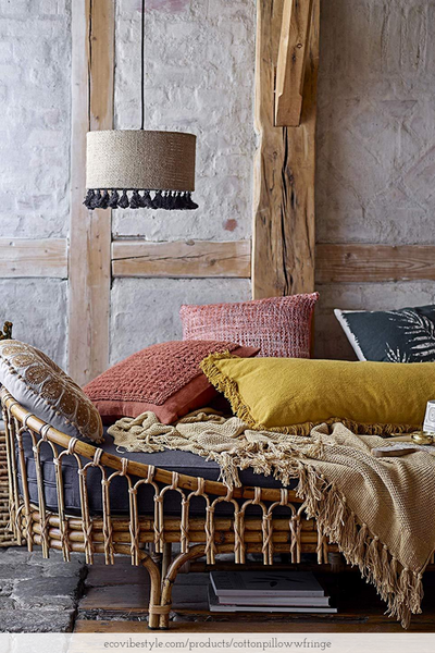 boho design room with layered pillows