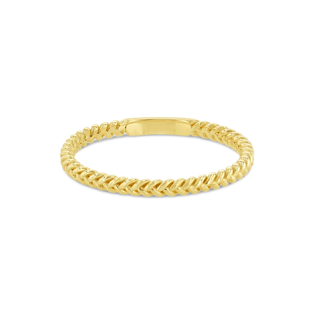 Delicate yellow gold braided ring against white background.