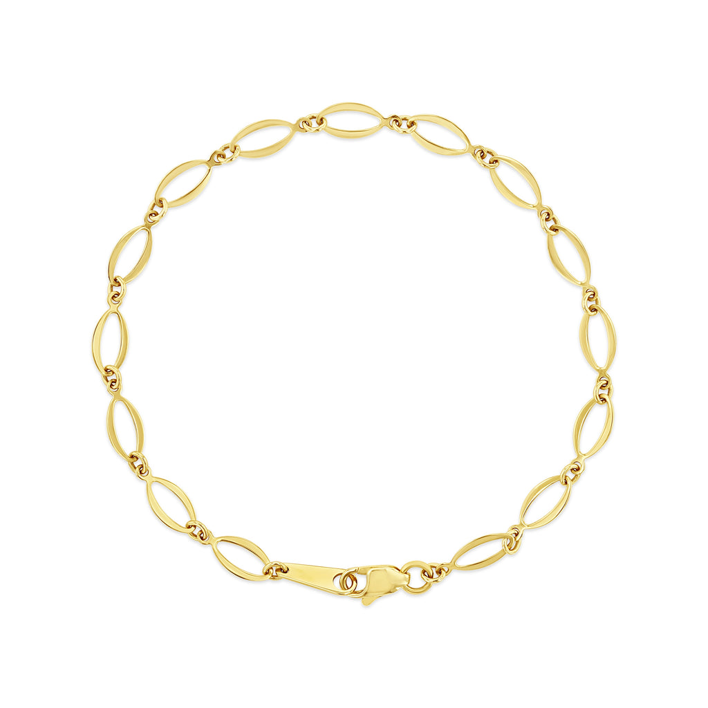 Yellow gold circle link bracelet laying against white background.