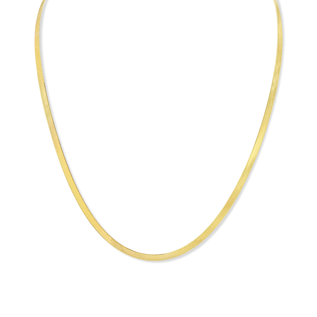 Delicate yellow gold herringbone necklace against white background.