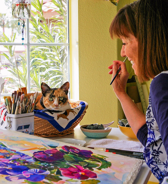 Female artist Robin St. Louis with her cat Bailey