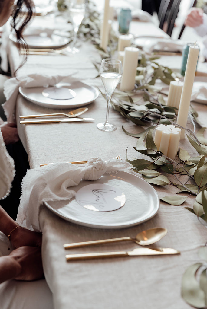 milk white frayed cotton napkins with beige linen tablecloth