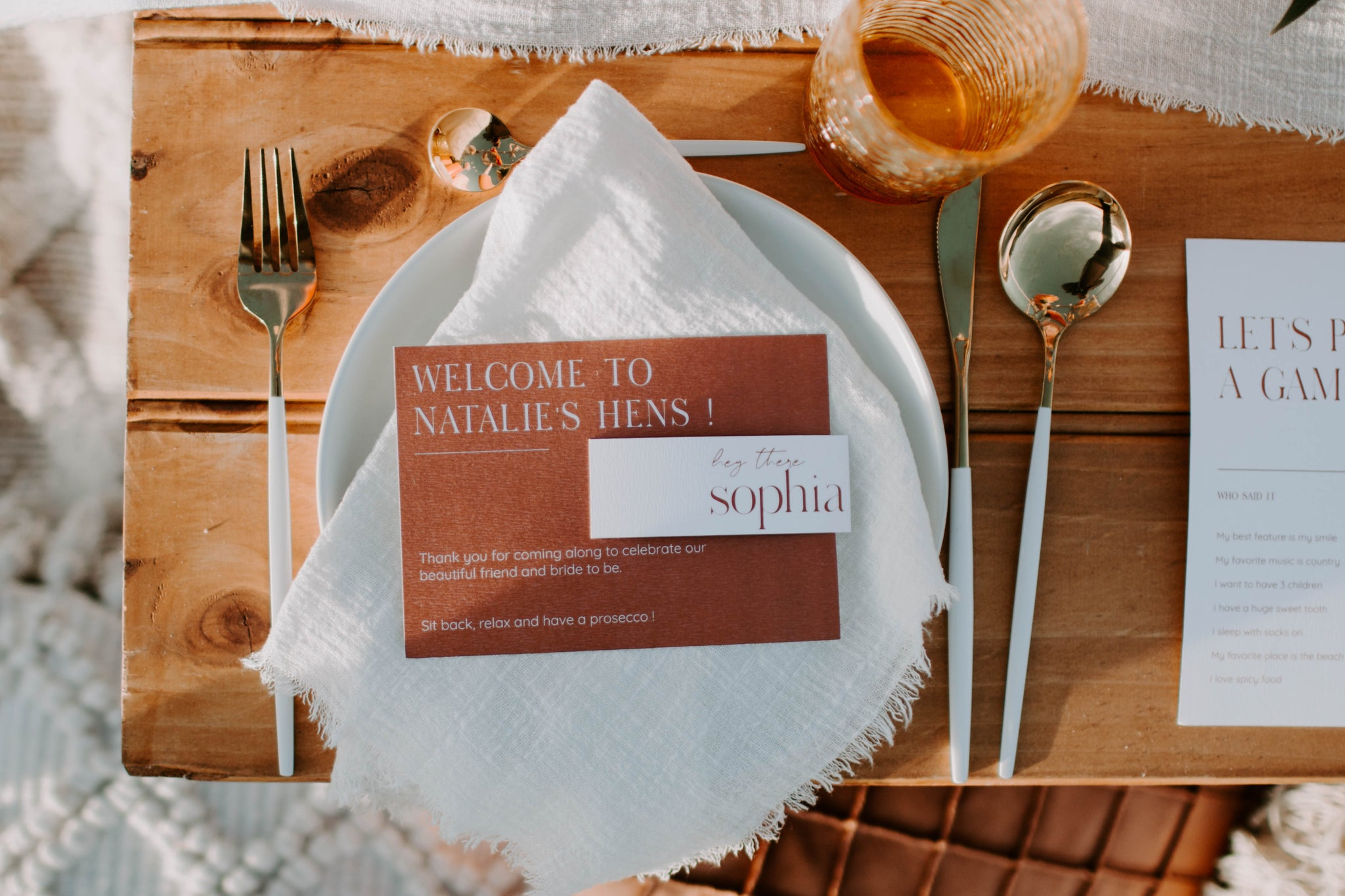 white linen table setting with terracotta hues