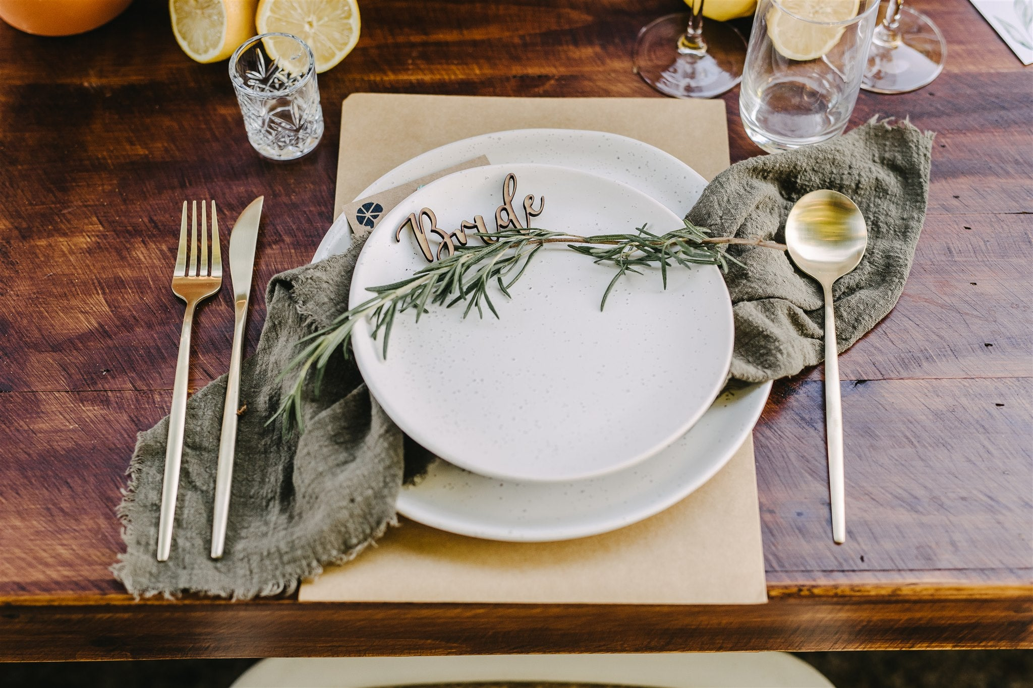 olive napkins wedding reception table setting gold cutlery