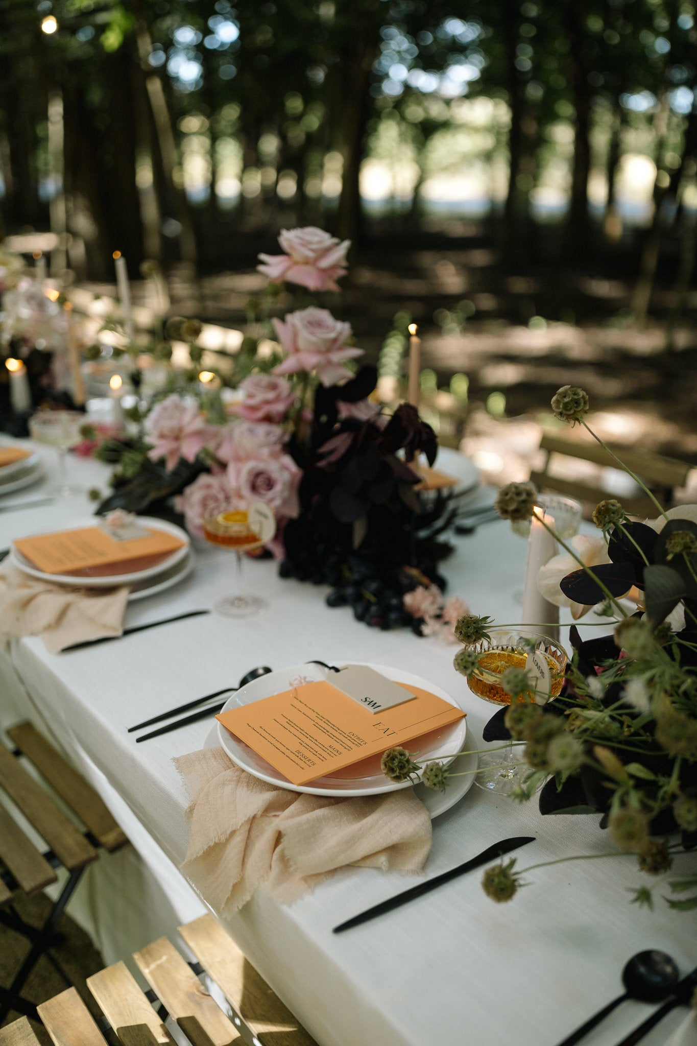blush pink frayed cotton napkins outdoor reception picnic table setting