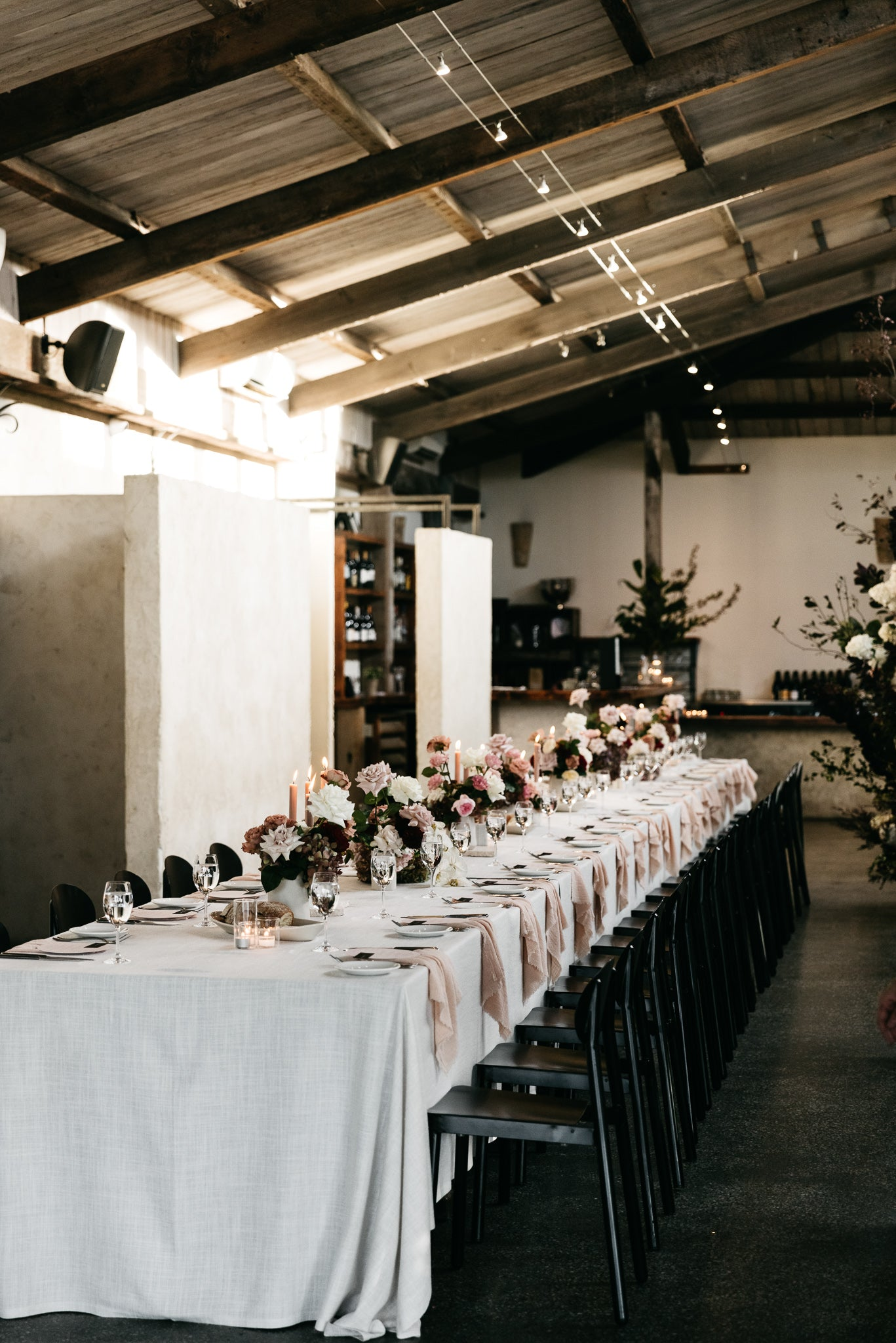 wedding reception stones of the yarra valley blush pink napkins red roses black chairs