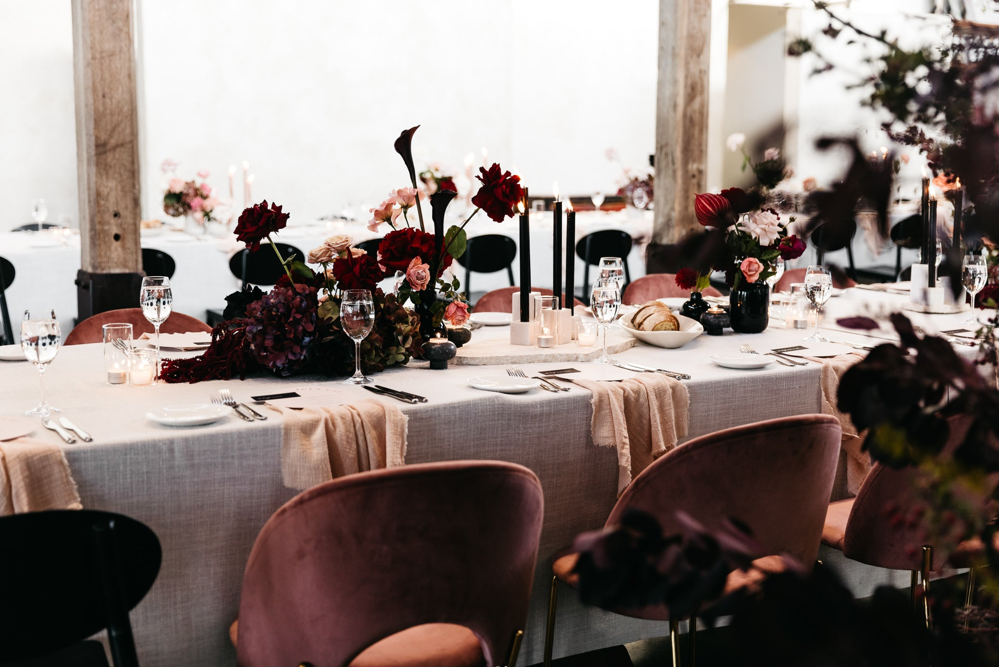 wedding reception stones of the yarra valley blush pink napkins red roses velvet chairs