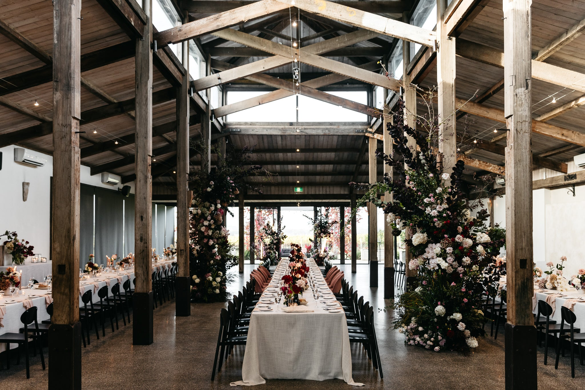 wedding reception stones of the yarra valley moody romantic sophisticated red roses