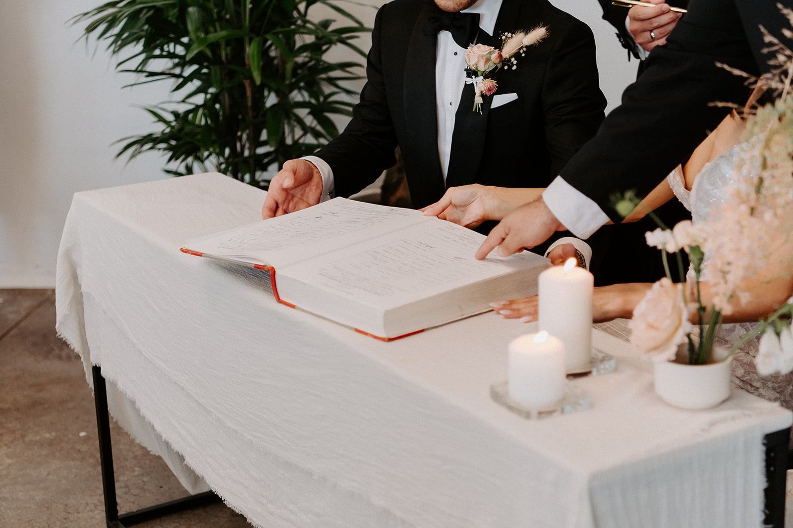wedding signing table with neutral sand cotton frayed table runner