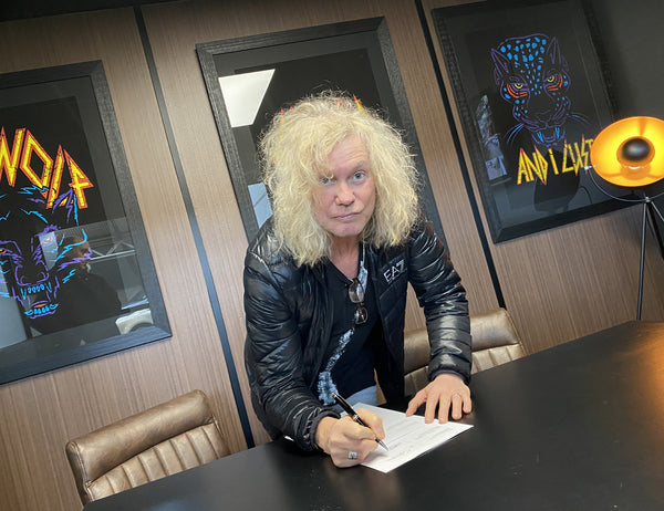 Def Leppard Band Member Signs Contract