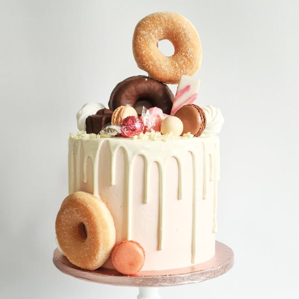 Gorgeous pink doughnut drip birthday or celebration cake on the Isle of Man