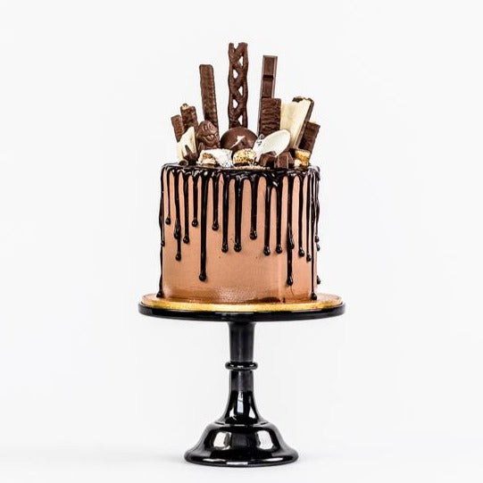 Chocolate fully loaded drip cake for birthday celebration Isle of Man