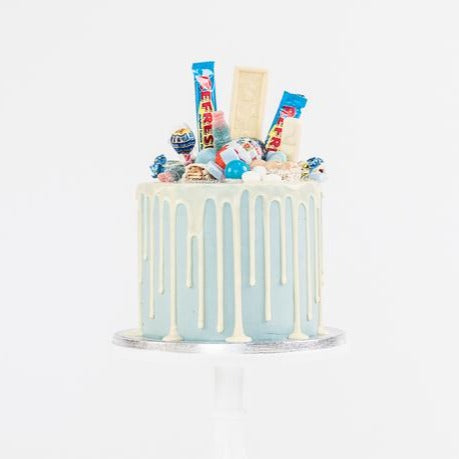 Blue fully loaded drip cake for birthday celebration on the Isle of Man