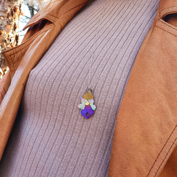 detail of model wearing Bloom True Necklace, deep violet-gold