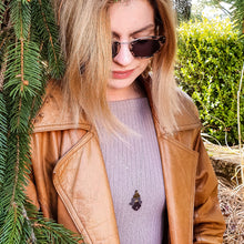 Load image into Gallery viewer, woman in brown leather jacket and purple sweater wearing the Bloom True Necklace, deep violet-gold