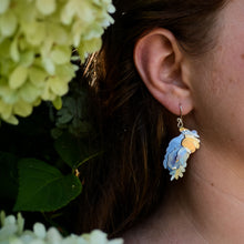 Load image into Gallery viewer, detail of model wearing the She Found Her Wings Earrings in cerulean blue-sunshine yellow