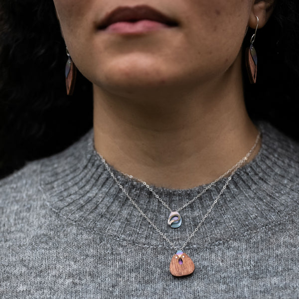 detail of The Rhythm of Rain Necklace layered with The Root of Things Necklace