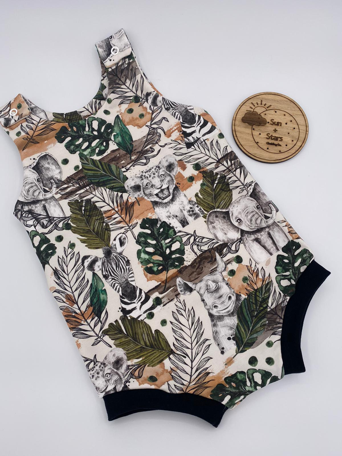 Our legless romper in jungle fabric with a black cuff