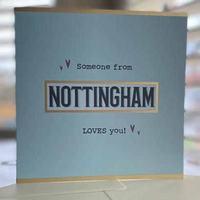 pale blue card saying 'someone from Nottingham loves you'