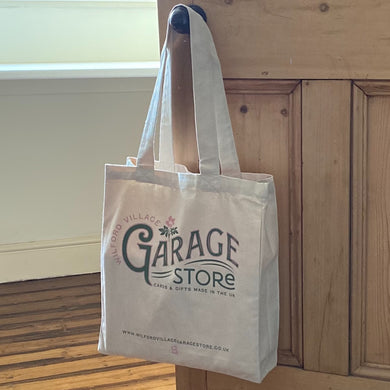 photo of totebag hanging on door handle with text Wilford Village Garage Store CARDS AND GIFTS MADE IN THE UK