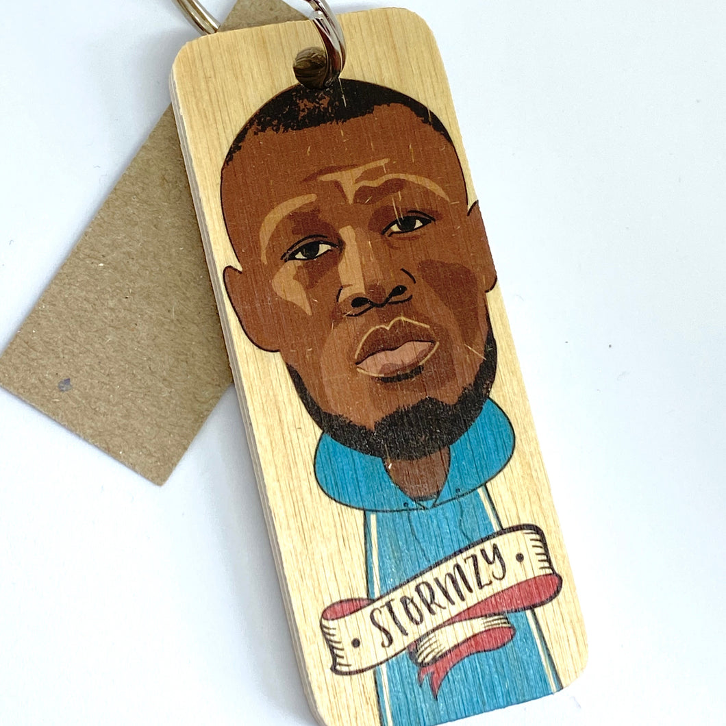 wooden keyring featuring illustration of Stormzy
