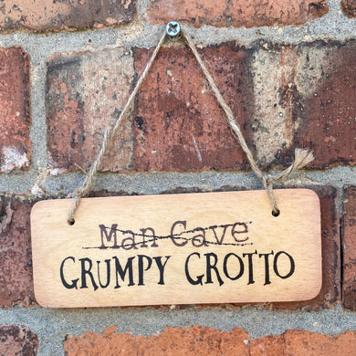 Rustic Wooden Sign with Man Cave crossed out and the words 'Grumpy Grotto' written underneath