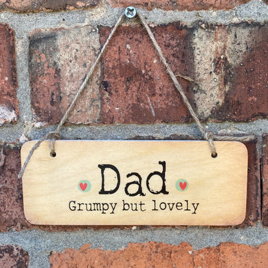 Rustic wooden sign saying 'Dad, Grumpy but Lovely'