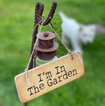 Load image into Gallery viewer, another image of wooden sign with wording 'I'm in the Garden'