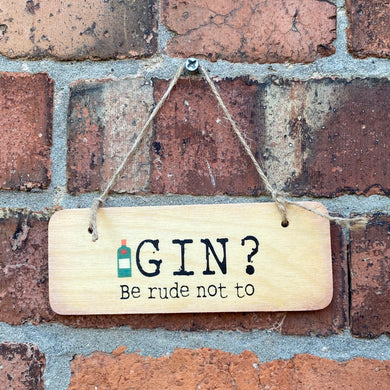 wooden sign with wording 'GIN? Be rude not to'
