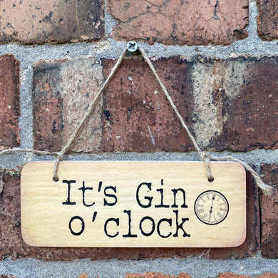 wooden sign with wording 'It's Gin O Clock'
