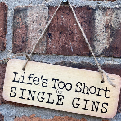 wooden sign with wording 'Life's too Short for Single Gins'