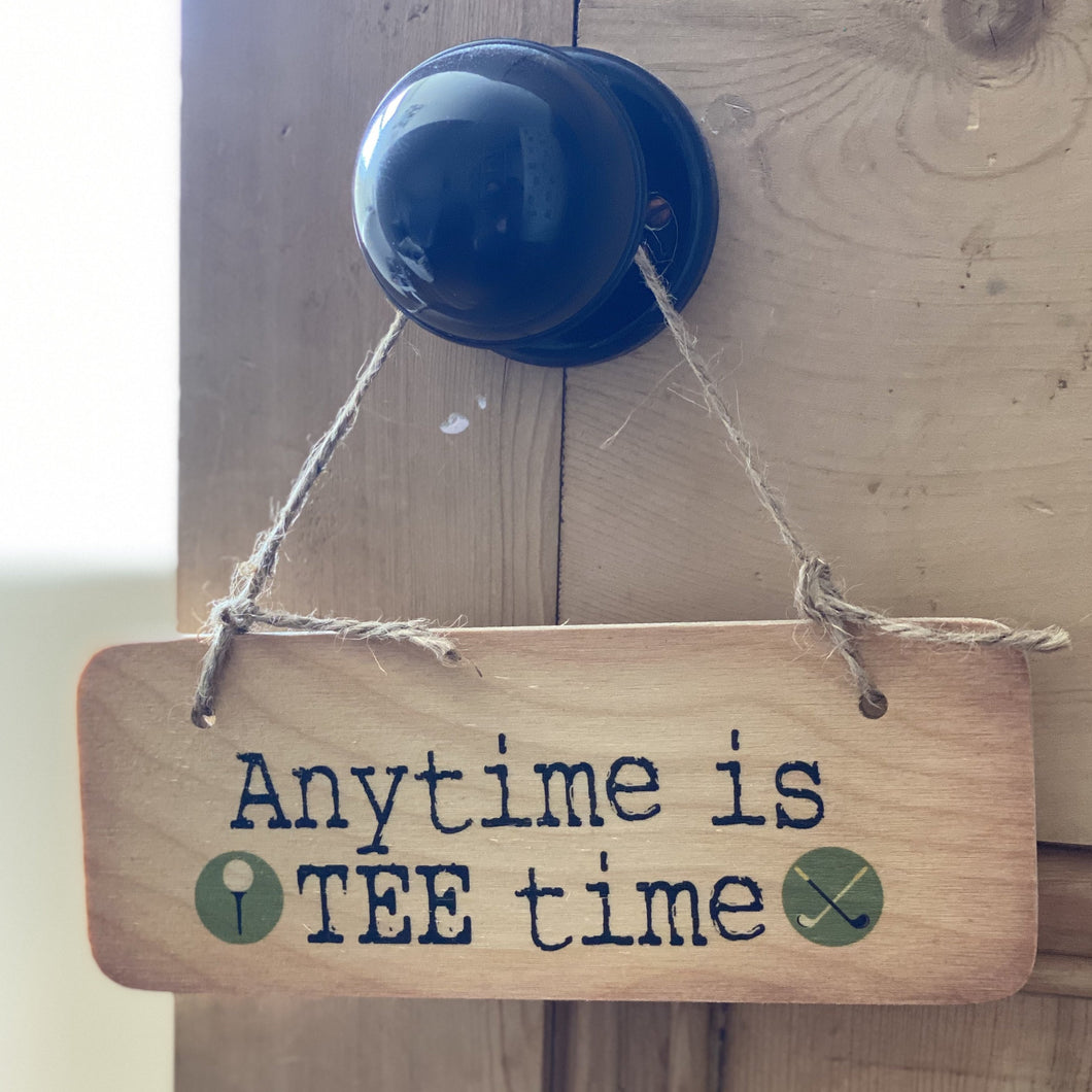 wooden sign with wording 'anytime is tee time'