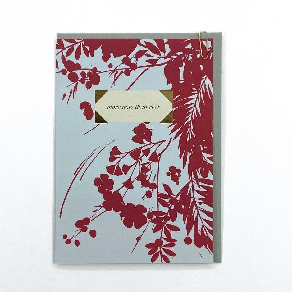 card with pale blue background and raspberry flowers and foliage saying the text  'more now than ever'