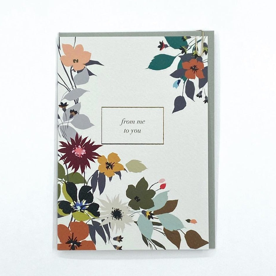 card with white background and flowers saying in text 'from me to you'