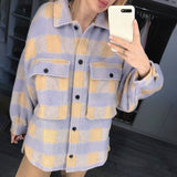 Stylish plaid jacket with puff sleeve and pockets, Vega brand.
