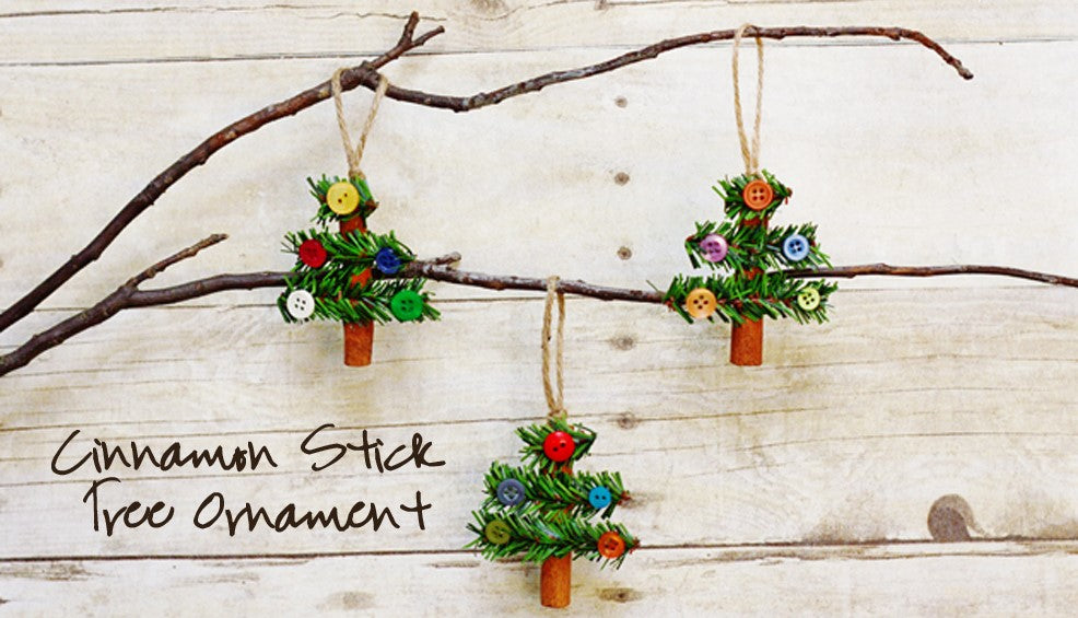 Cinnamon stick Christmas ornaments with pine garlands.