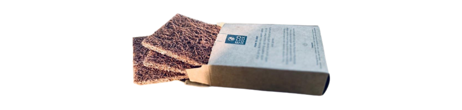 Three compostable coconut scourers shown in cardboard packaging.