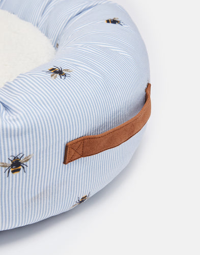 This signature Joules print doughnut design has blue ticking and a bee motif.  Designed especially for your cat or small dog, it is thickly padded on all sides with a non slip base, and a reversible cosy cushion.